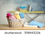 flasket of clean towels on table | Shutterstock . vector #598443236