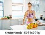 sporty woman standing near... | Shutterstock . vector #598469948