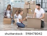 family unpacking cardboard...   Shutterstock . vector #598478042