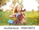 beautiful girl playing violin | Shutterstock . vector #598478072