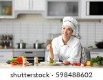 female chef salt vegetable...   Shutterstock . vector #598488602
