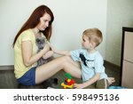 a child with her mother is...   Shutterstock . vector #598495136