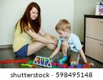 a child with her mother is... | Shutterstock . vector #598495148