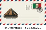 an envelope with a postage... | Shutterstock .eps vector #598526222