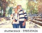 travel and tourism. senior... | Shutterstock . vector #598535426