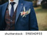 the groom in a suit and a vest... | Shutterstock . vector #598540955