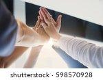 hands of success startup... | Shutterstock . vector #598570928