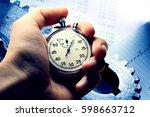 hand holding stopwatch on... | Shutterstock . vector #598663712