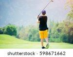 golfer hitting golf shot with... | Shutterstock . vector #598671662