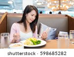 woman using cellphone and... | Shutterstock . vector #598685282