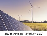wind mills and solar panel at... | Shutterstock . vector #598694132