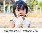 kid eating ice cream. fun curly ... | Shutterstock . vector #598701926