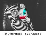 young attractive dangerous... | Shutterstock . vector #598720856
