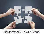 close up of four hands holding...   Shutterstock . vector #598739906