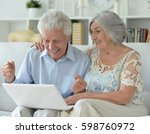 elderly couple with a laptop | Shutterstock . vector #598760972