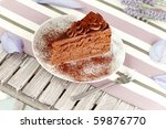 macro of a tasty chocolate cake on a white dish - stock photo