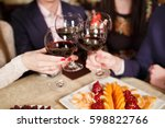 friends at a restaurant... | Shutterstock . vector #598822766
