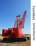 red crane on construction site - stock photo