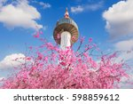 seoul tower and pink cherry... | Shutterstock . vector #598859612