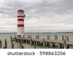 lighthouse by the lake | Shutterstock . vector #598863206