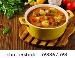 beef stew served with cooked... | Shutterstock . vector #598867598