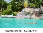 Young Woman Floating In A Pool! - stock photo