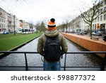 back view of a tourist with the ... | Shutterstock . vector #598877372