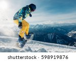 snowboarder is jumping with... | Shutterstock . vector #598919876