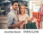beautiful couple with shopping... | Shutterstock . vector #598921298