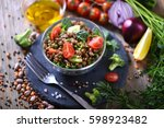 lentil salad with veggies ... | Shutterstock . vector #598923482