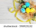 easter eggs in the nest. rustic ... | Shutterstock . vector #598925132