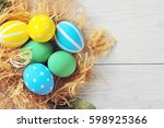 easter eggs in the nest. rustic ... | Shutterstock . vector #598925366