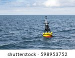 lonely buoy in ocean | Shutterstock . vector #598953752