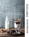 delicious milkshake with ice... | Shutterstock . vector #598972322