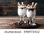 delicious milkshake with ice...   Shutterstock . vector #598972412