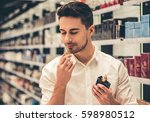 handsome guy is choosing... | Shutterstock . vector #598980512