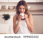 beautiful blonde girl in home... | Shutterstock . vector #599003102