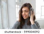 teen girl in fluffy earphones... | Shutterstock . vector #599004092