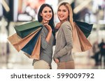 beautiful girls with shopping... | Shutterstock . vector #599009792