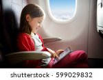 adorable little girl traveling... | Shutterstock . vector #599029832