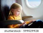 adorable little girl traveling... | Shutterstock . vector #599029928