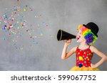 let's party  funny kid clown.... | Shutterstock . vector #599067752
