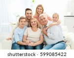 happy family gathered in living ... | Shutterstock . vector #599085422
