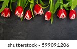 Row Of Red Tulips Against A...