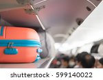 carry on luggage on the top... | Shutterstock . vector #599140022