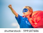 funny little girl plays super... | Shutterstock . vector #599187686