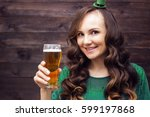 smiling girl with beer on... | Shutterstock . vector #599197868