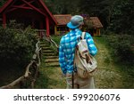 man with a backpack hiking in... | Shutterstock . vector #599206076
