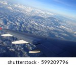 Clouds Under The Wing Of An...