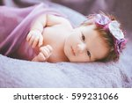 Stock photo cute little child lying on the lilac purple plaid 599231066